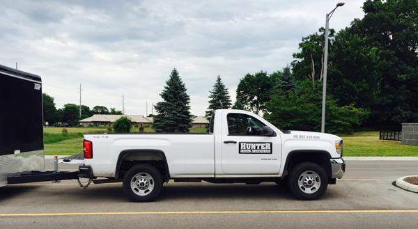 White Hunter Lawn Service Truck